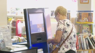 Park Library user checking out her books