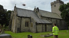 Drone flying over graveyard