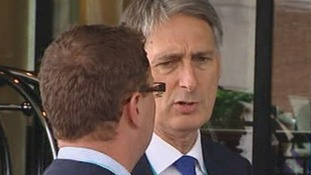 Philip Hammond outside the Conservative Party Conference in Birmingham