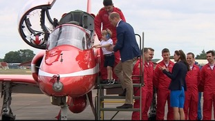Prince George sits in Red Arrows Hawk cockpit ahead of Air Tattoo