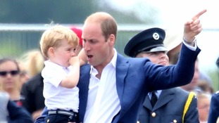 Prince George looks on at aircraft with his father at RAF Fairford.