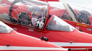Prince George tries out the pilot seat in the Red Arrows Hawk.