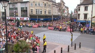 Crowds line the streets of Cardiff waiting for a glimpse of their sporting heroes