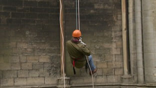 More than 200 people had signed up to abseil down the historic building