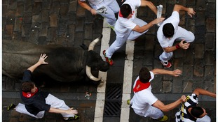 Two men gored on third day of bull-running festival