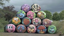 Hay bales painted by graffiti artist Kev Largey in Fivemiletown.