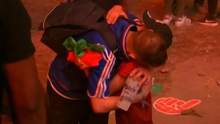 Portuguese boy consoles distraught French fan after Euro 2016 final