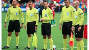 Referee Mark Clattenburg (centre) and his officials before the game.