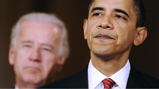 U.S. President Barack Obama is flanked by Vice President Joe Biden