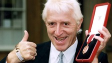 Sir Jimmy Savile after he received his knighthood f