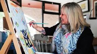 Dawn Booth-Wilson with her artwork