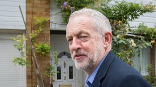 Corbyn leaving his north London home earlier.