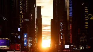 'Manhattanhenge': Stunning sunset in New York city as it dips in line with the city's grid
