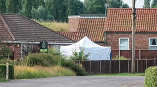 Police tent at the scene where the two bodies were found