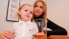 Sonny with his mother and a drink