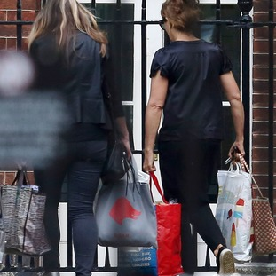 women carry bags from number 10