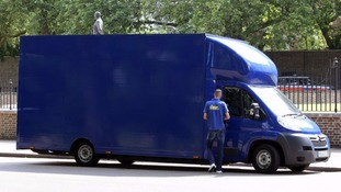 A blue removal van arrives at 10 Downing Street
