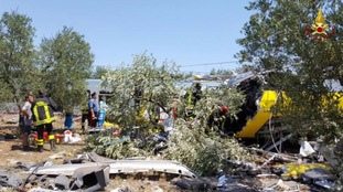 Emergency services at the scene of the crash in the middle of an olive grove in the southern village of Corato, near Bari, Italy.
