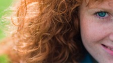 Portrait of a redheaded woman.