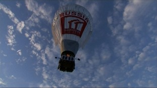 Russian adventurer takes off on solo around the world trip in West built hot air balloon