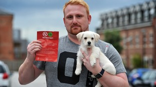 Clifton Green with his puppy and one of the leaflets