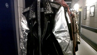 A rack of costumes back-stage.