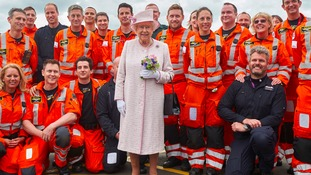 The Queen poses for a picture with crew from the East Anglian Air Ambulance.