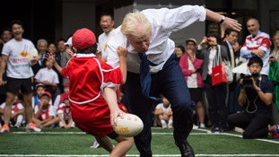 Boris Johnson played street rugby in Tokyo.