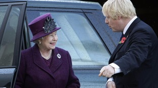 Britain's Queen Elizabeth II is greeted by Boris Johnson.