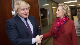 Boris Johnson shakes hands with Hillary Clinton.