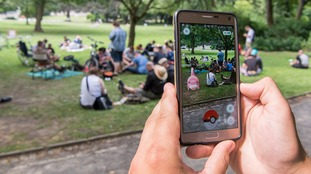 A player uses the PokemonGo app in Germany.