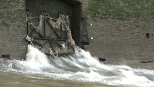 Water and raw sewage spills into the River Thames from a combined sewer overflow.