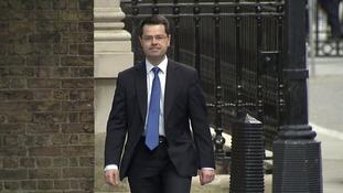 James Brokenshire walking to Number 10