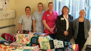 Quilts given to North Tees Hospital, Marjorie Cook 2nd from right with the team from North Tees Hospital