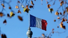 A French flag flies at half mast