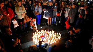 Australia's French community gather for a candlelight vigil in Sydney.