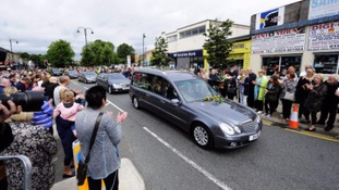 Mourners applaud as the coffin of Labour MP Jo Cox passes through Heckmondwike, West Yorkshire, ahead of her private funeral service.