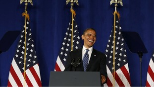 President Barack Obama smiles before he speaks at a campaign event in Miami