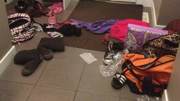 Shoes, clothes and bags clutter up the hallway