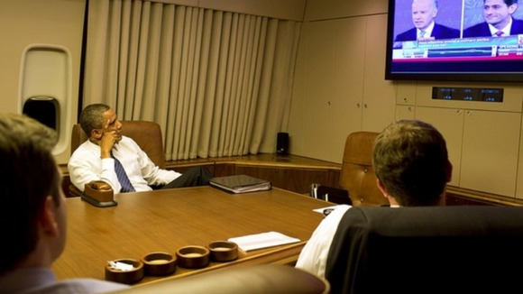 President Obama watches his deputy Joe Biden's debate performance
