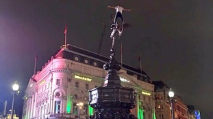 Chaos as man climbs Eros statue in Piccadilly Circus