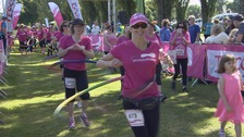 Ladies hula hooping throughout the 20th 5k Race