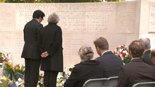 Relatives of victims pay their own respects at the memorial