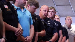 Police attend a vigil in Louisiana after the shooting of three officers