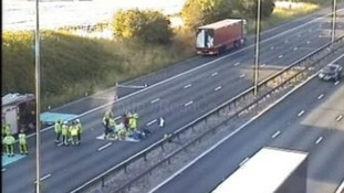 Road repair works on the M6 after acid spillage.
