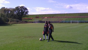 Edgar Davids on the pitch at Barnet FC's training ground.