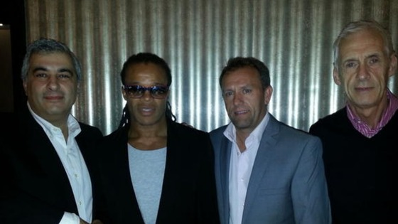 Edgar Davids with Barnet&#x27;s Chairman Tony Kleanthous, incumbent Head Coach Mark Robson, and Director of Football Paul Fairclough.