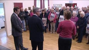 Stephen Hughes speaks to protestors