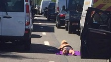 Woman sunbathes in the middle of motorway closed after crash