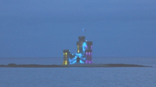 The island's Tower of Refuge lit in the colours of the rainbow flag during a recent tribute.